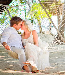 Newly wedded couple on a beach, Fiji